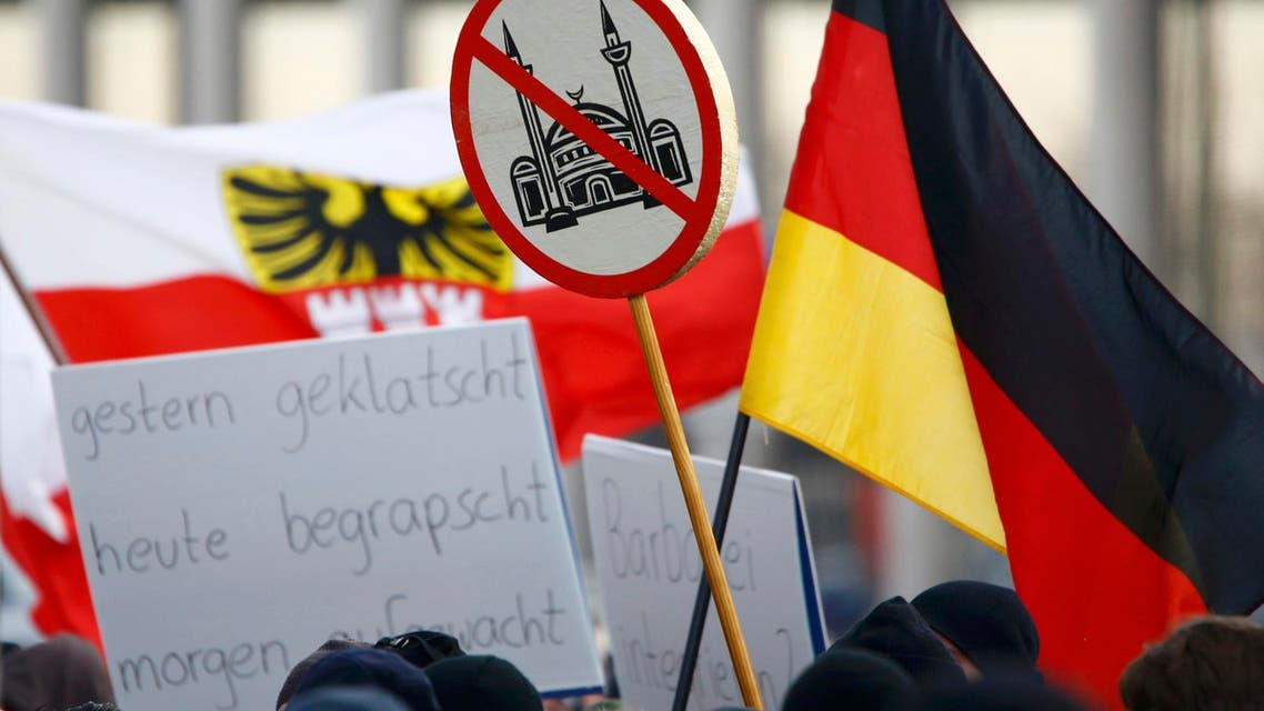 Supporters of anti-immigration right-wing movement PEGIDA (Patriotic Europeans Against the Islamisation of the West) take part in in demonstration rally, in reaction to mass assaults on women on New Year's Eve, in Cologne, Germany, January 9, 2016. reuters