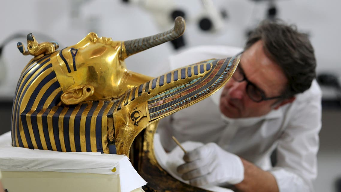 German conservator Christian Eckmann works on the restoration of the golden mask of King Tutankhamun at the Egyptian Museum in Cairo, Egypt, October 20, 2015. REUTERS
