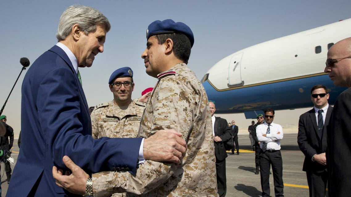 U.S. Secretary of State John Kerry says goodbye to Saudi Arabian military personnel as he leaves Riyadh. (Reuters)