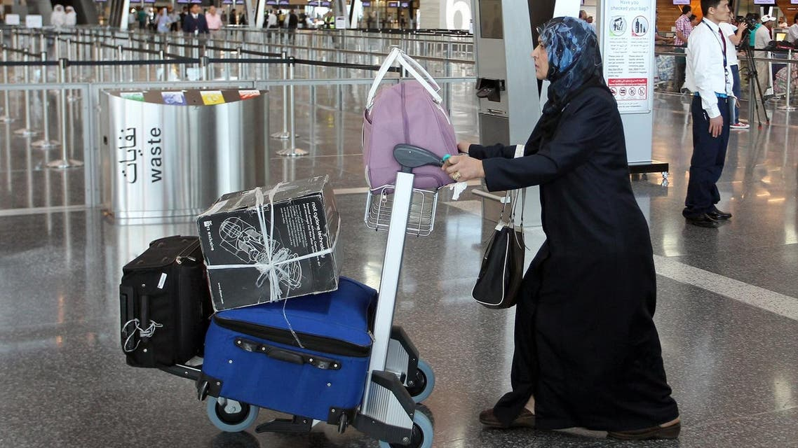 A passenger walks to the check-in area inside the Hamad International Airport, in Doha, Qatar, Tuesday, May 27, 2014. (AP)