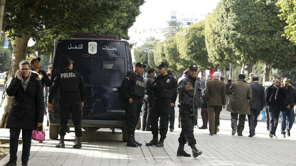 Police officers stand guard on Habib Bourguiba Avenue in Tunis, Tunisia January 22, 2016. REUTERS