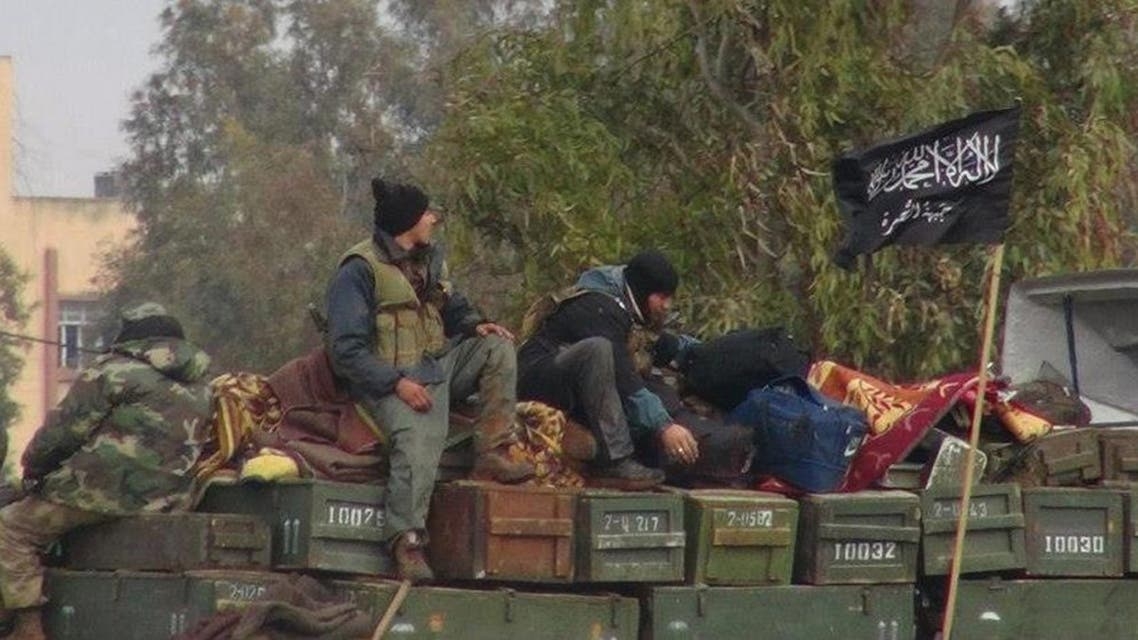 In this Friday, Jan. 11, 2013 file photo, citizen journalism image provided by an anti-Bashar Assad activist group Edlib News Network (ENN), which has been authenticated based on its contents and other AP reporting, rebels from al-Qaida-affiliated Jabhat al-Nusra, also known as the Nusra Front, sit on a truck full of ammunition at Taftanaz air base, that was captured by the rebels in Idlib province, northern Syria. The Nusra Front, Syria's al-Qaida affiliate, is consolidating power in territory stretching from the Turkish border to central and southern Syria, crushing moderate opponents and forcibly converting minorities using tactics akin to its ultraconservative rival, the Islamic State group. (AP Photo/Edlib News Network ENN, File)