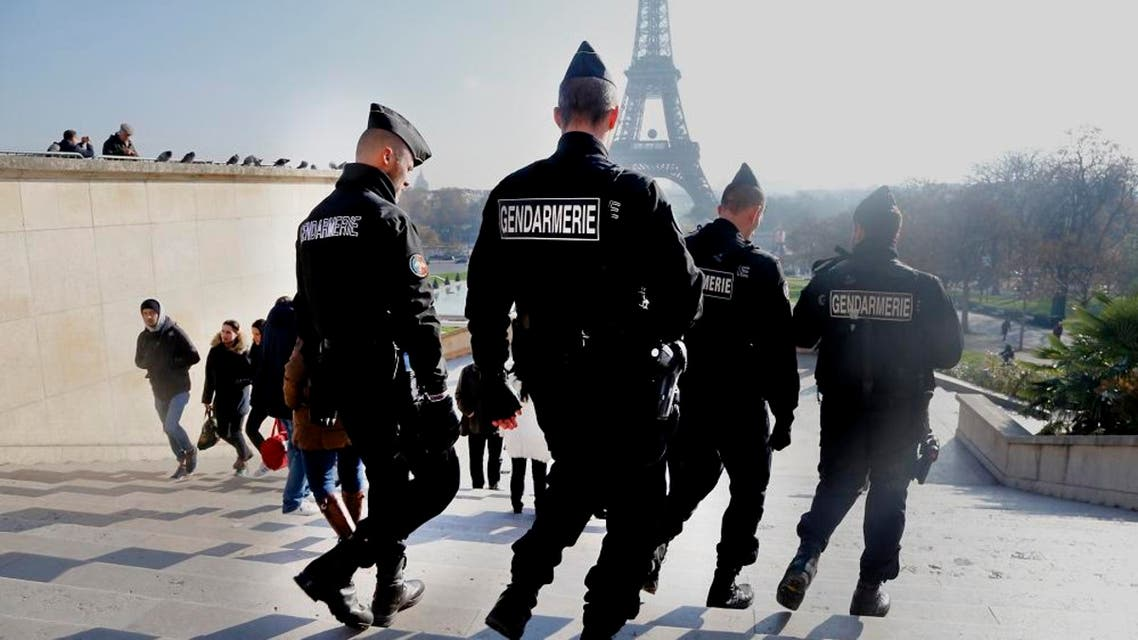 In this Monday, Nov. 23, 2015 file photo, French gendarmes officers patrol near the Eiffel Tower, in Paris. In the aftermath of the horrifying attacks in Paris on Nov. 13, 2015, people were so jittery that some loud, unremarkable noises were enough to send some people scurrying for help. Some experts say it will take months for Europeans to adapt to life after the paris attacks. (AP Photo/Jacques Brinon, File)
