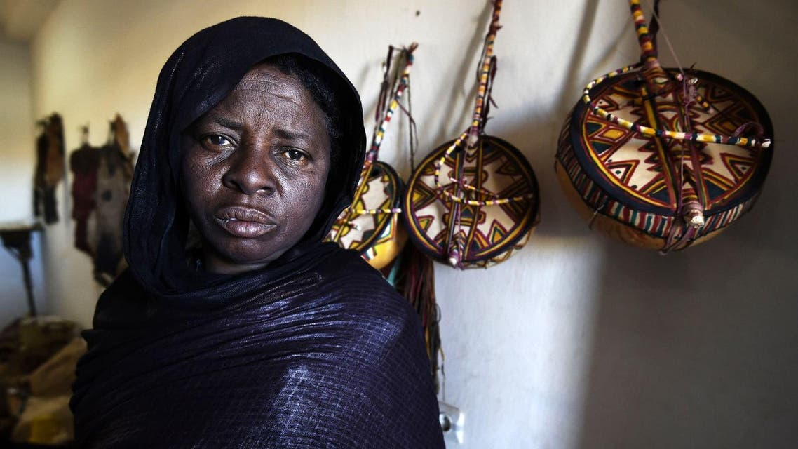 """A Tuareg woman who is an imzad instrument maker poses for a picture at the """"Home of the Imzad"""" in Tamanrasset in Southern Algeria. (AFP)"""