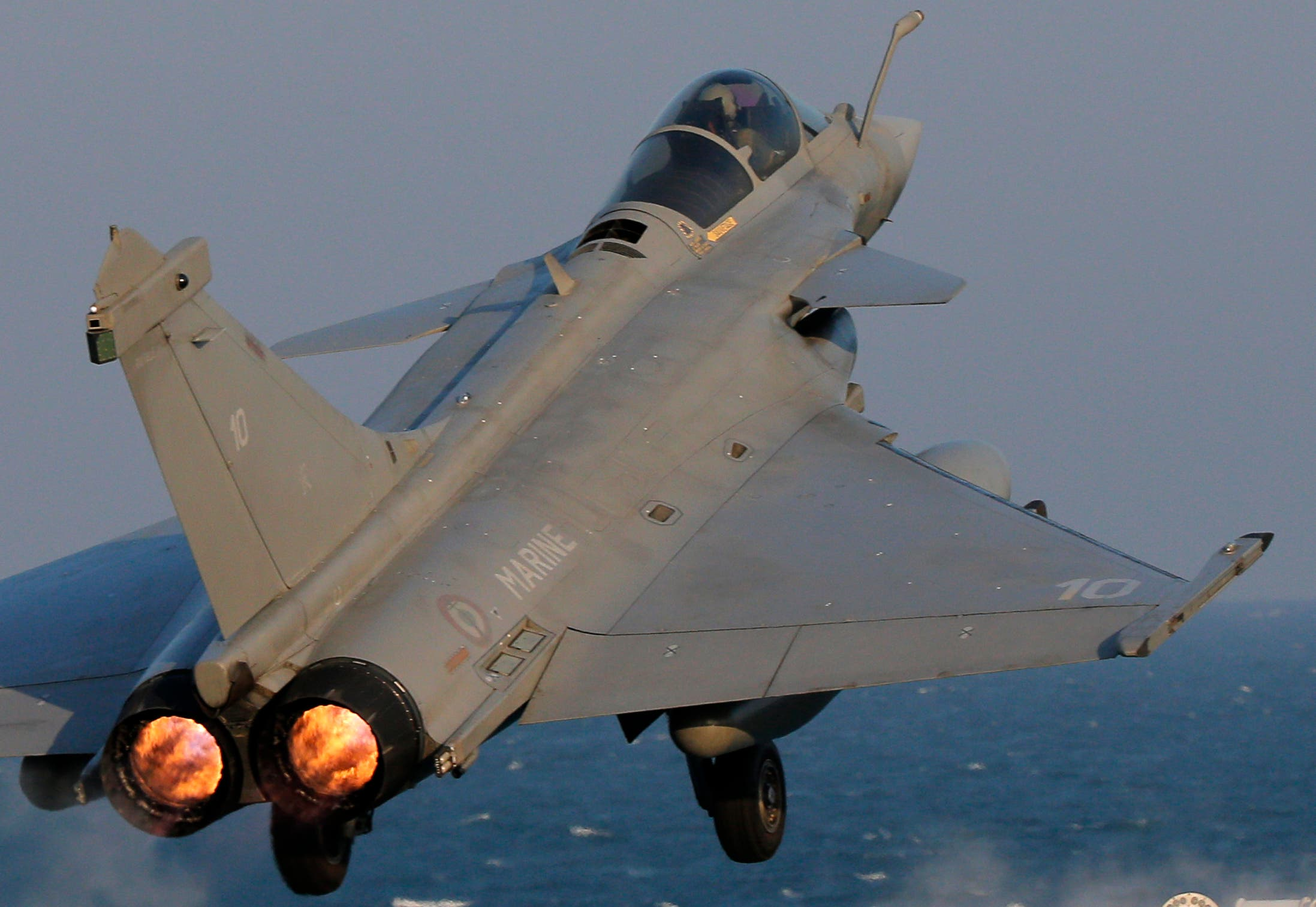 A Rafale fighter jet is catapulted for a mission, on France's flagship Charles de Gaulle aircraft carrier in the Persian Gulf, Wednesday, Jan. 13, 2016. The Charles de Gaulle joined the U.S.- led coalition against Islamic State group in November, as France intensified its airstrikes against extremist sites in Syria and Iraq in response to Islamic State group threats against French targets. (AP Photo/Christophe Ena)