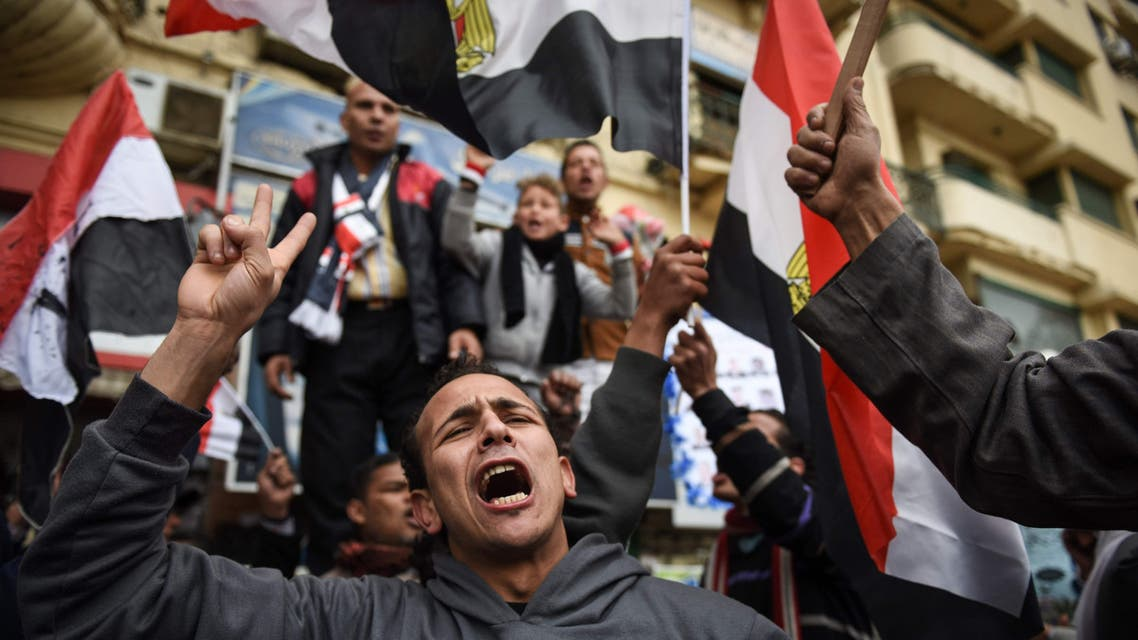 Egyptians holding national flags gather on Cairo's landmark Tahrir Square on January 25, 2016, as the country marks the fifth anniversary of the 2011 uprising. AFP
