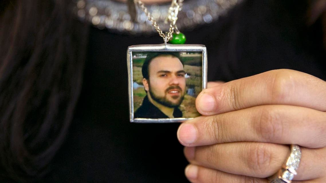 Naghmeh Abedini, holds a necklace with a photograph of her husband, Saeed Abedini, on Capitol Hill in Washington, Tuesday, June 2, 2015. (AP)
