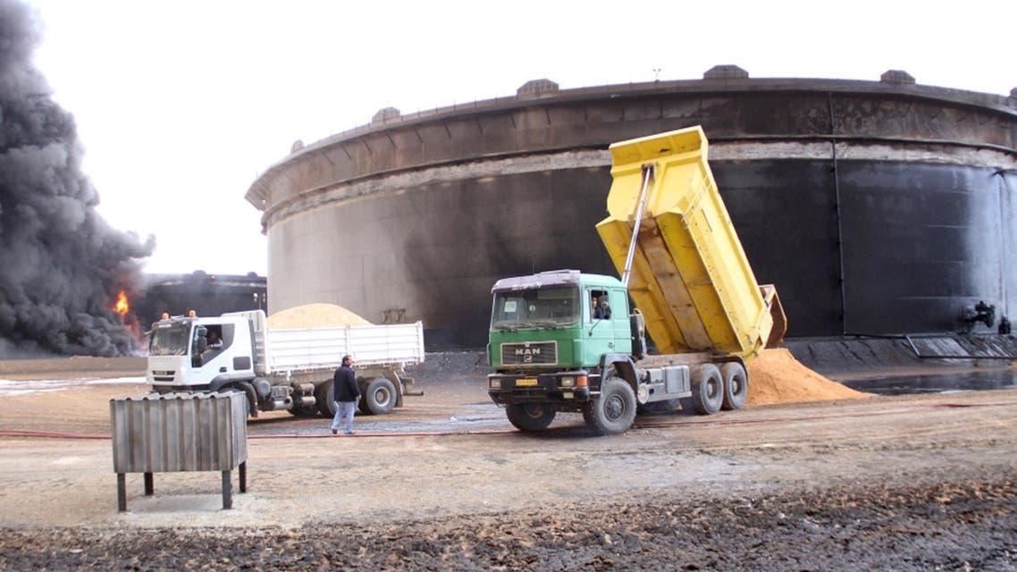 Smoke rises from burning oil storage tanks in the port of Ras Lanuf, Libya, January 23, 2016.  (Reuters)