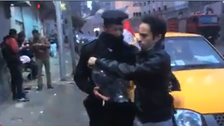 Video of Egyptians giving police condom balloons goes viral