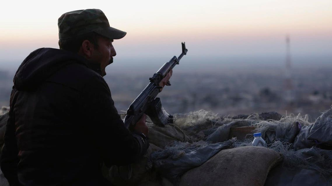 A peshmerga, yawns as he stands guard on the frontline in Sinjar, Iraq. (AP)
