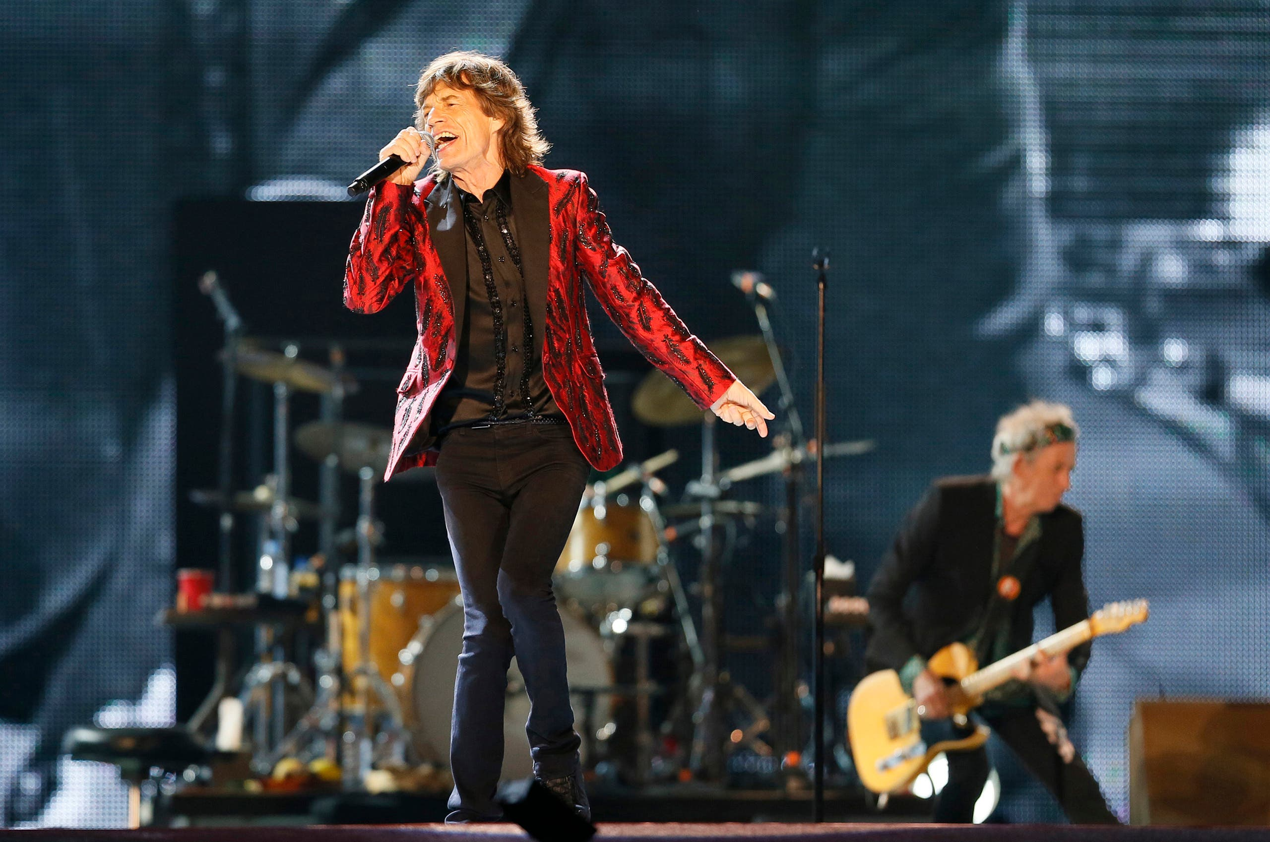 Mick Jagger of the Rolling Stones performs during a concert in Abu Dhabi in 2014 (AP)