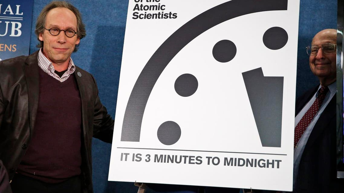 Lawrence Krauss, left, the chair of the Bulletin of Atomic Scientists, and former ambassador Thomas R. Pickering, far right, stand after unveiling the 'Doomsday Clock' that remains at three minutes to midnight. (AP)