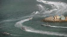 Iran warned U.S. warship to leave drill area
