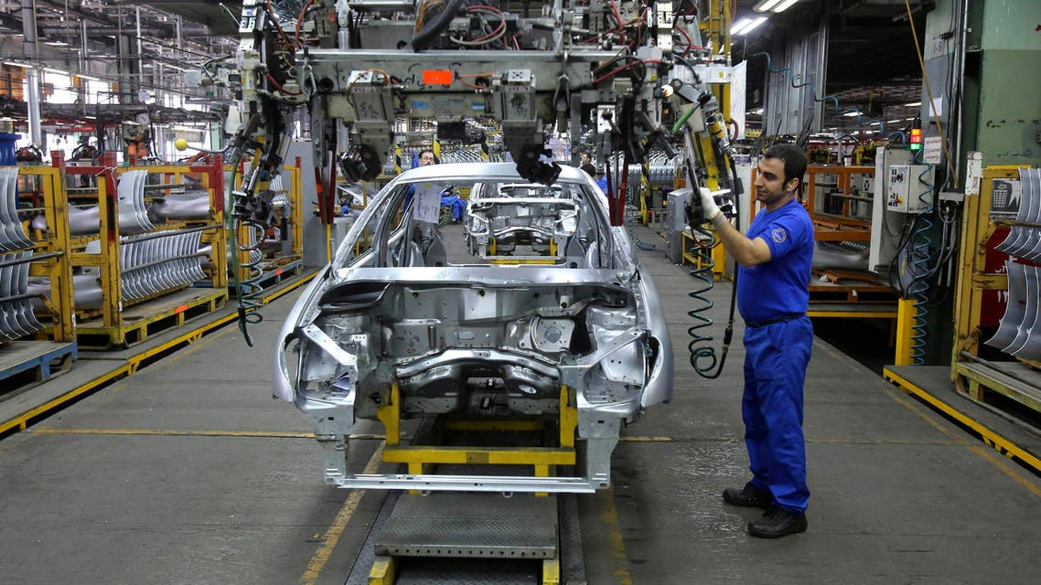 In this Saturday, Jan. 18, 2014 file photo, an Iranian worker assembles a car at the Iran Khodro automobile manufacturing plant, just outside Tehran, Iran.  (AP)