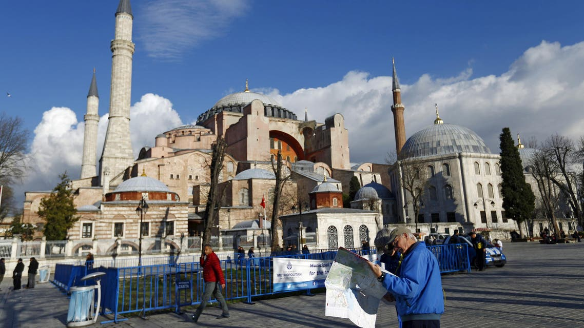 A tourist couple checks a map, near the Byzantine-era monument of Hagia Sophia, at Sultanahmet square in Istanbul,Turkey January 14, 2016. (Reuters)
