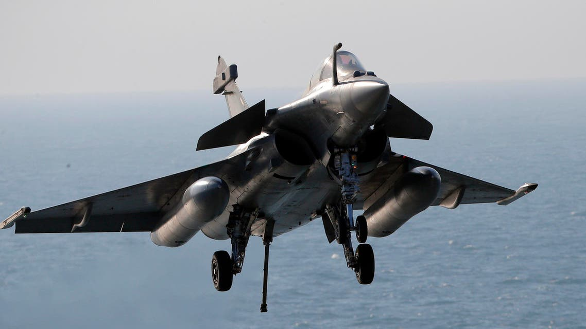 A Rafale fighter jet lands after a mission, on France's flagship Charles de Gaulle aircraft carrier in the Persian Gulf, Wednesday, Jan. 13, 2016. The Charles de Gaulle joined the U.S.- led coalition against Islamic State group in November, as France intensified its airstrikes against extremist sites in Syria and Iraq in response to Islamic State group threats against French targets. (AP Photo/Christophe Ena)