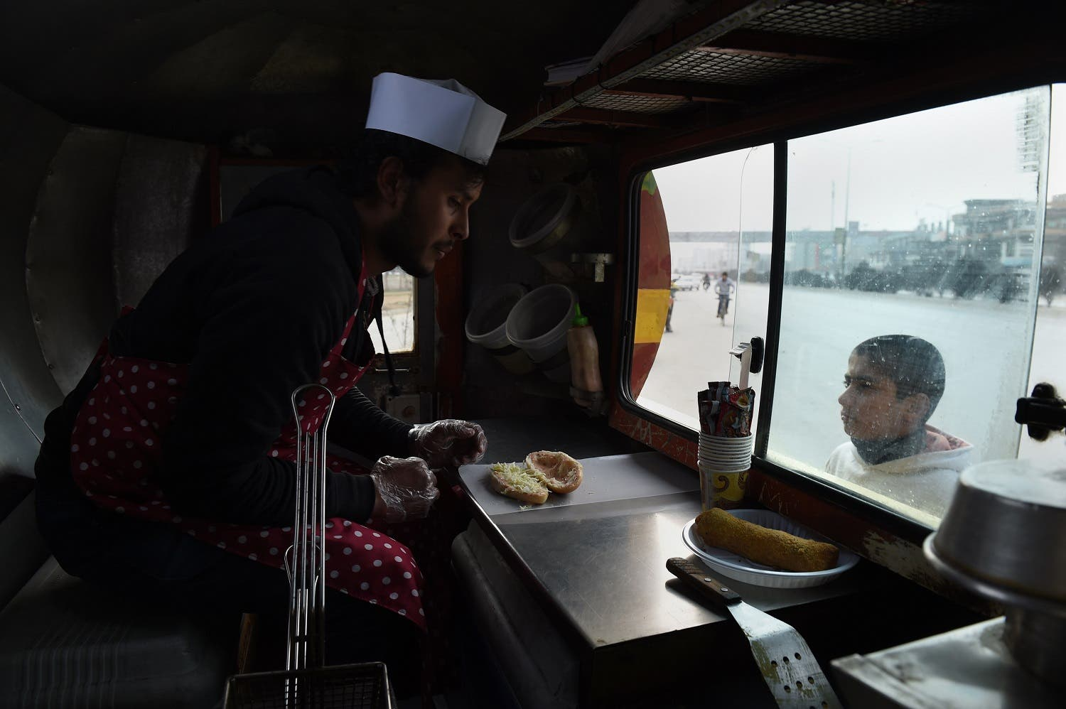 It took little time for the city's emerging middle class to embrace the novelty of canteens-on-wheels serving Western fast foods around town. (AFP)