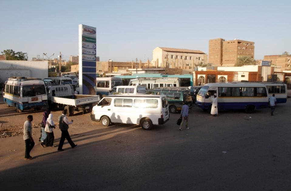A file photo shows drivers queue up in their vans for fuel at a gas station in the Sudanese capital Khartoum. (AFP)