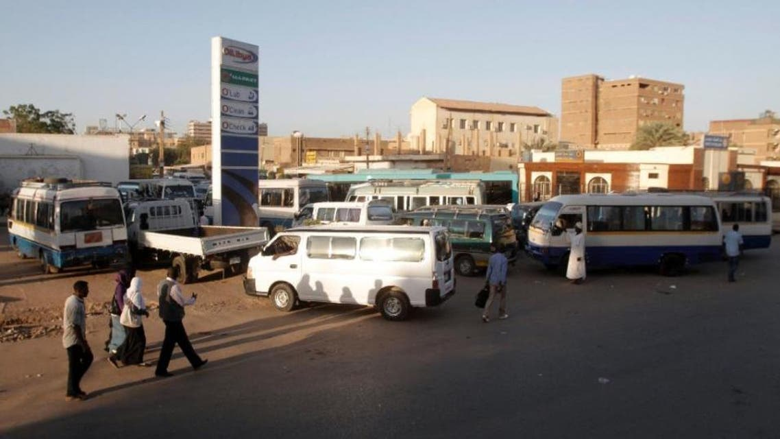 Drivers queue up in their vans for fuel at a gas station in the Sudanese capital Khartoum. (AFP)