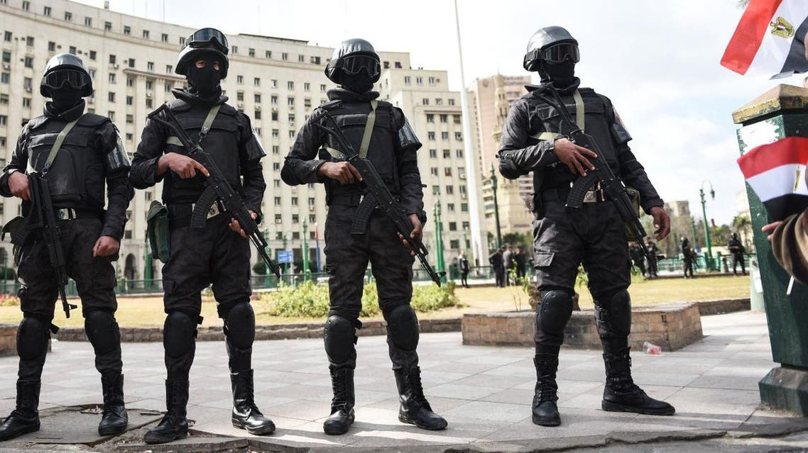 Members of the Egyptian police special forces stand guard on Cairo's landmark Tahrir Square on January 25, 2016. (AFP)