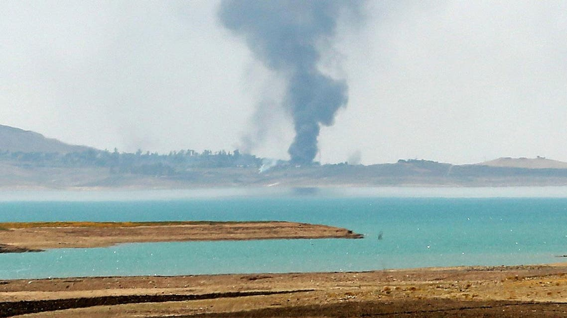 Smoke rises during airstrikes targeting Islamic State militants at the Mosul Dam outside Mosul, Iraq, Monday, Aug. 18, 2014. Boosted by two days of U.S. airstrikes, Iraqi and Kurdish forces on Monday wrested back control of the country's largest dam from Islamic militants, a military spokesman in Baghdad said, as fighting was reported to be underway for the rest of the strategic facility. (AP Photo/Khalid Mohammed)