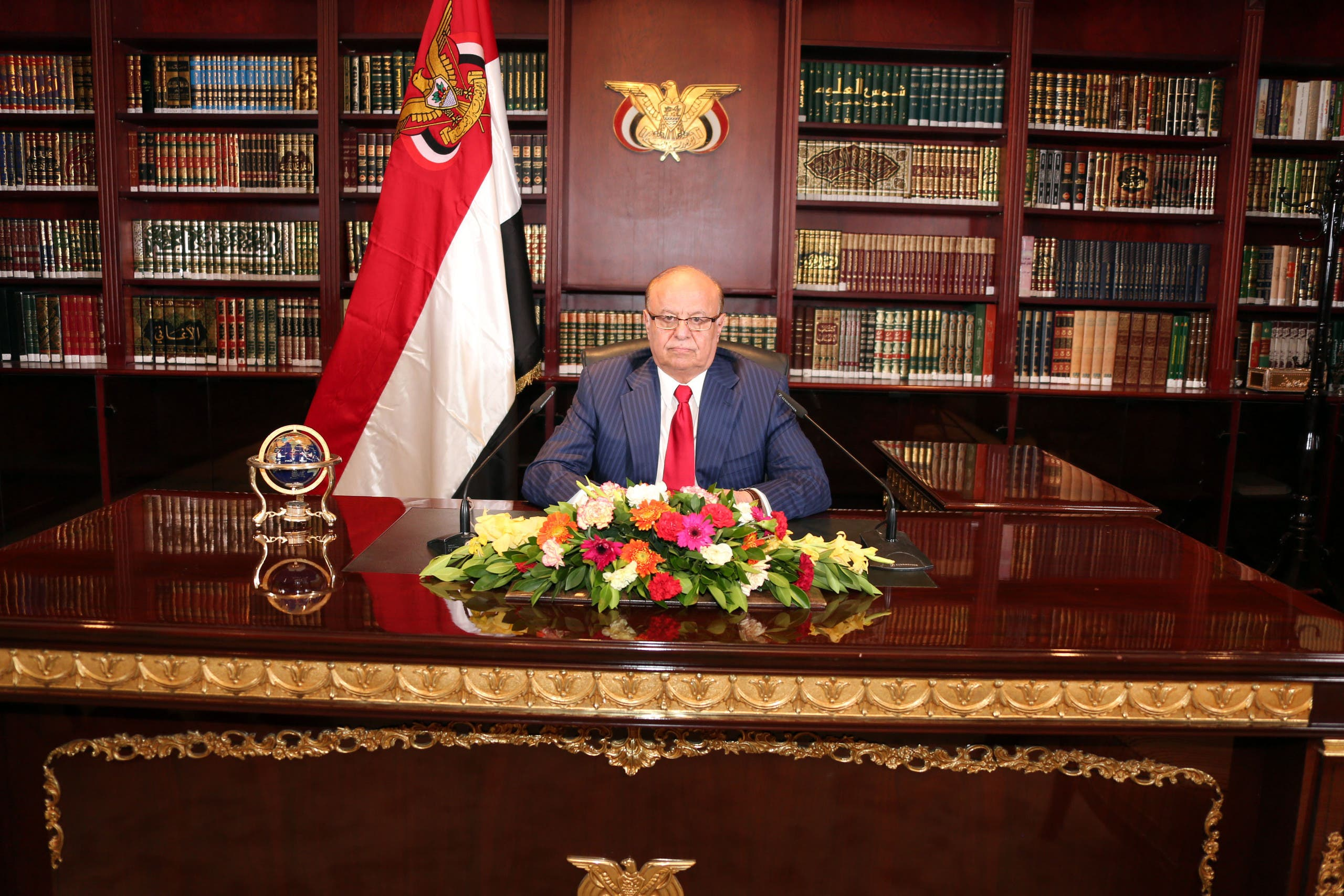 In this photo provided by Yemen's Presidency Office, Yemeni President Abed Rabbo Mansour Hadi delivers a speech in his office at Presidential Palace on the occasion of the 52nd anniversary of North Yemen's the September 26, 1962 revolution in Sanaa, Yemen, Thursday, Sept. 25, 2014. (AP Photo/Yemen's Presidency Office)