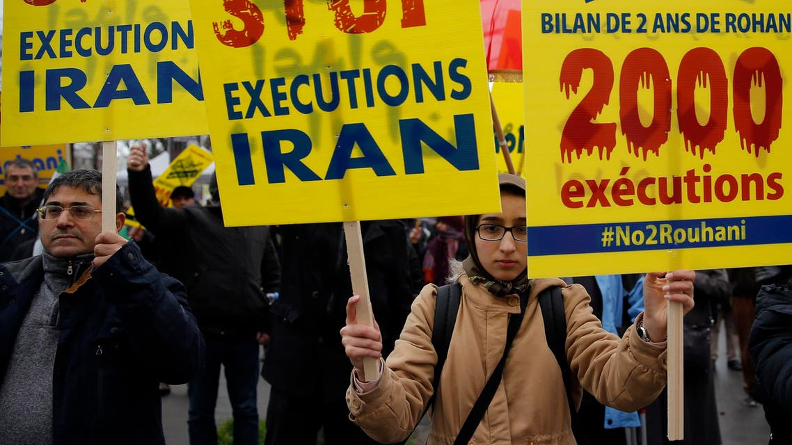 Supporters of Maryam Rajavi, President of the National Council of Resistance of Iran, demonstrate against the Iranian President Hassan Rowhani's visit in Paris, Wednesday, Jan. 27, 2016. (AP)