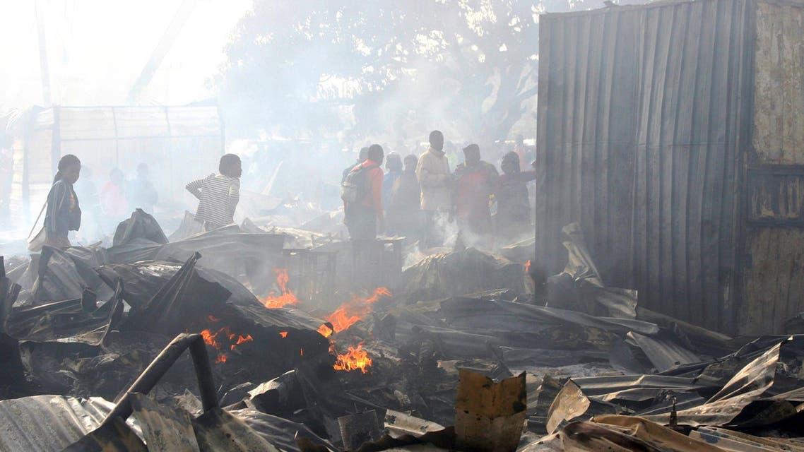 People inspect the damage after a fire broke out at Kaduna Railway Station Market, Nigeria January 26, 2016. More than 100 shops were destroyed in the fire, local media reported. REUTERS/Stringer FOR EDITORIAL USE ONLY. NO RESALE. NO ARCHIVE.