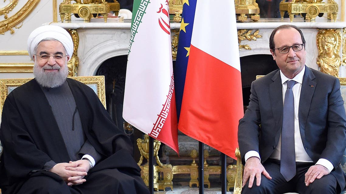 French president Francois Hollande, right, speaks with Iranian President Hassan Rouhani during a meeting at the Elysee Palace, in Paris, Thursday, Jan. 28, 2016.  (AP)
