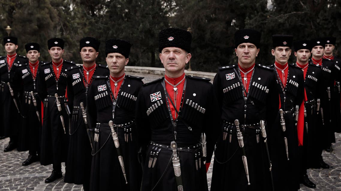 In this Monday, Jan. 11, 2016 photo, Circassian guards pose for a photograph outside Basman Palace, in Amman, Jordan. AP