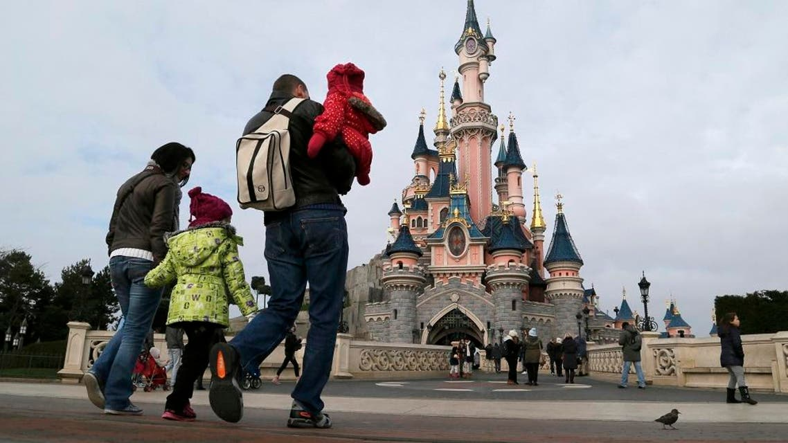 File picture shows visitors walking towards the Sleeping Beauty Castle during a visit to the Disneyland Paris Resort run by EuroDisney S.C.A in Marne-la-Vallee January 21, 2015. REUTERS/Gonzalo Fuentes/Files