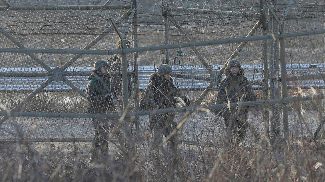 South Korean army soldiers patrol by the barbed-wire fence in Paju, near the border with North Korea, South Korea, Friday, Jan. 8, 2016. As world leaders debated ways to penalize North Korea's claim of a fourth nuclear test, South Korea voiced its displeasure with broadcasts of anti-Pyongyang propaganda across the rivals' tense border Friday, believed to be the birthday of North Korean leader Kim Jong Un. (AP Photo/Ahn Young-joon)