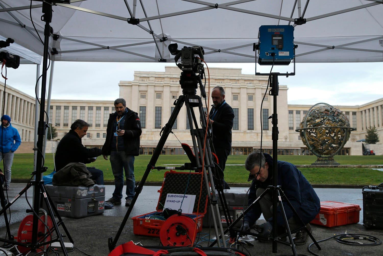 A television crew sets up ahead of the start of Syrian talks in front of the United Nations European headquarters in Geneva. (Reuters)