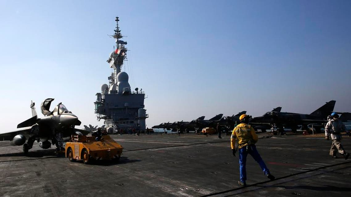A Rafale fighter jet is parked after a mission on France's flagship Charles de Gaulle aircraft carrier in the Persian Gulf, Wednesday, Jan. 13, 2016. The Charles de Gaulle joined the U.S.- led coalition against Islamic State group in November, as France intensified its airstrikes against extremist sites in Syria and Iraq in response to Islamic State group threats against French targets. (AP Photo/Christophe Ena)