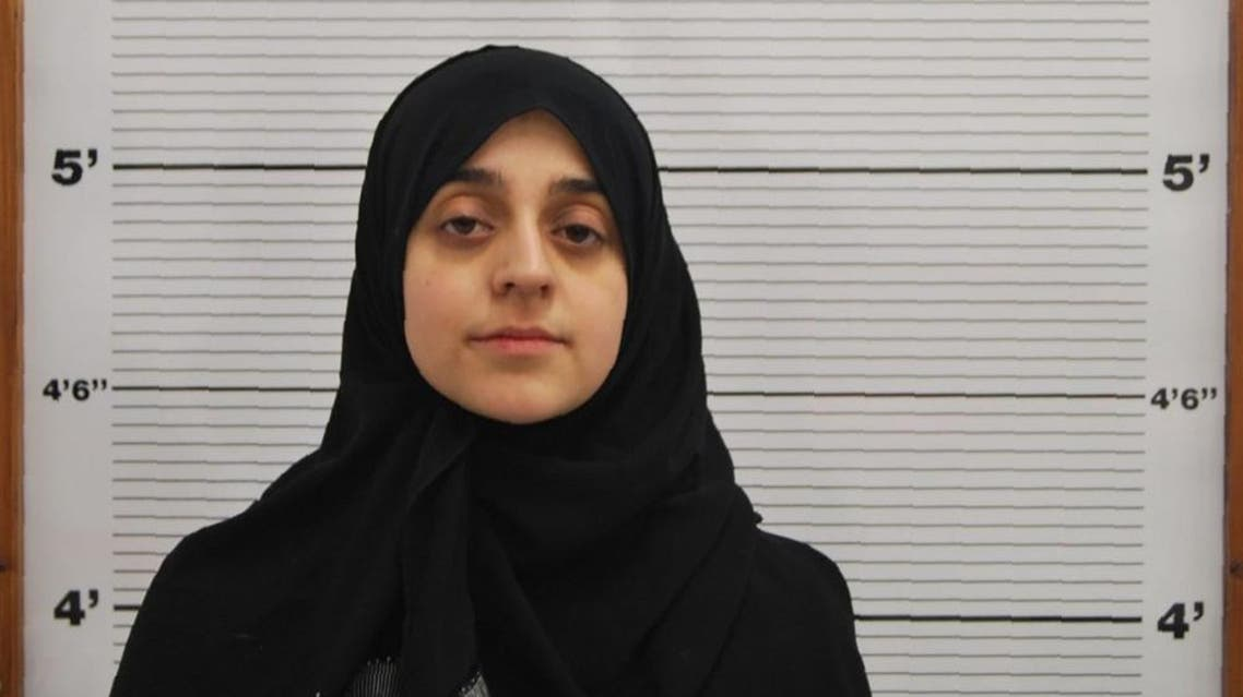 An undated handout photo released by West Midlands Police service and received in London on January 29, 2016, shows Tareena Shakil as she poses for a custody photograph with a head scarf. A mother who took her toddler to Syria and joined the Islamic State (IS) group is thought to have become the first British woman to be convicted after returning home. Tareena Shakil, 26, was found guilty of IS membership and encouraging terrorism in posts on Twitter before leaving Britain.