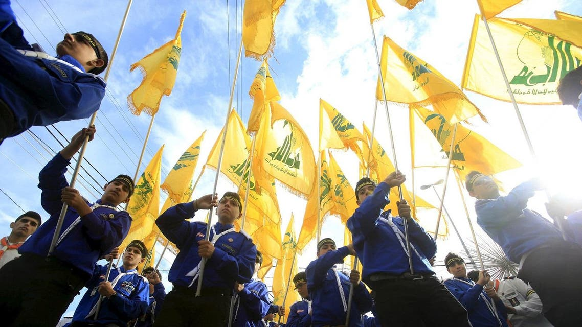Lebanon's Hezbollah scouts carry their parties flag while marching at the funeral of three Hezbollah fighters who were killed while fighting alongside Syrian army forces in Syria. (Reuters)