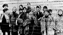 Germany raids homes of former SS men over war crimes