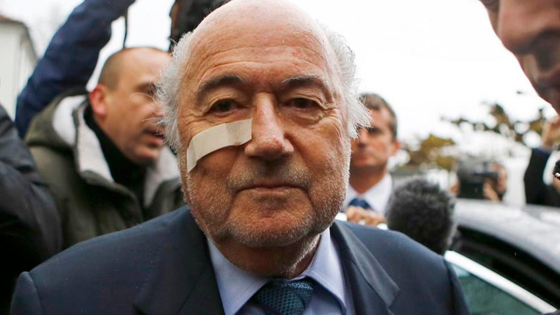In this Dec. 21, 2015 file photo, FIFA President Sepp Blatter arrives for a news conference in Zurich, Switzerland, after he was banned for 8 years from all football-related activities over a $2 million payment by FIFA to Michel Platini, the president of European soccer's ruling body UEFA. 2015 was the year when scandals off the field of play eclipsed exploits on it. (AP Photo/Matthias Schrader, File)  Use Information This content is intend