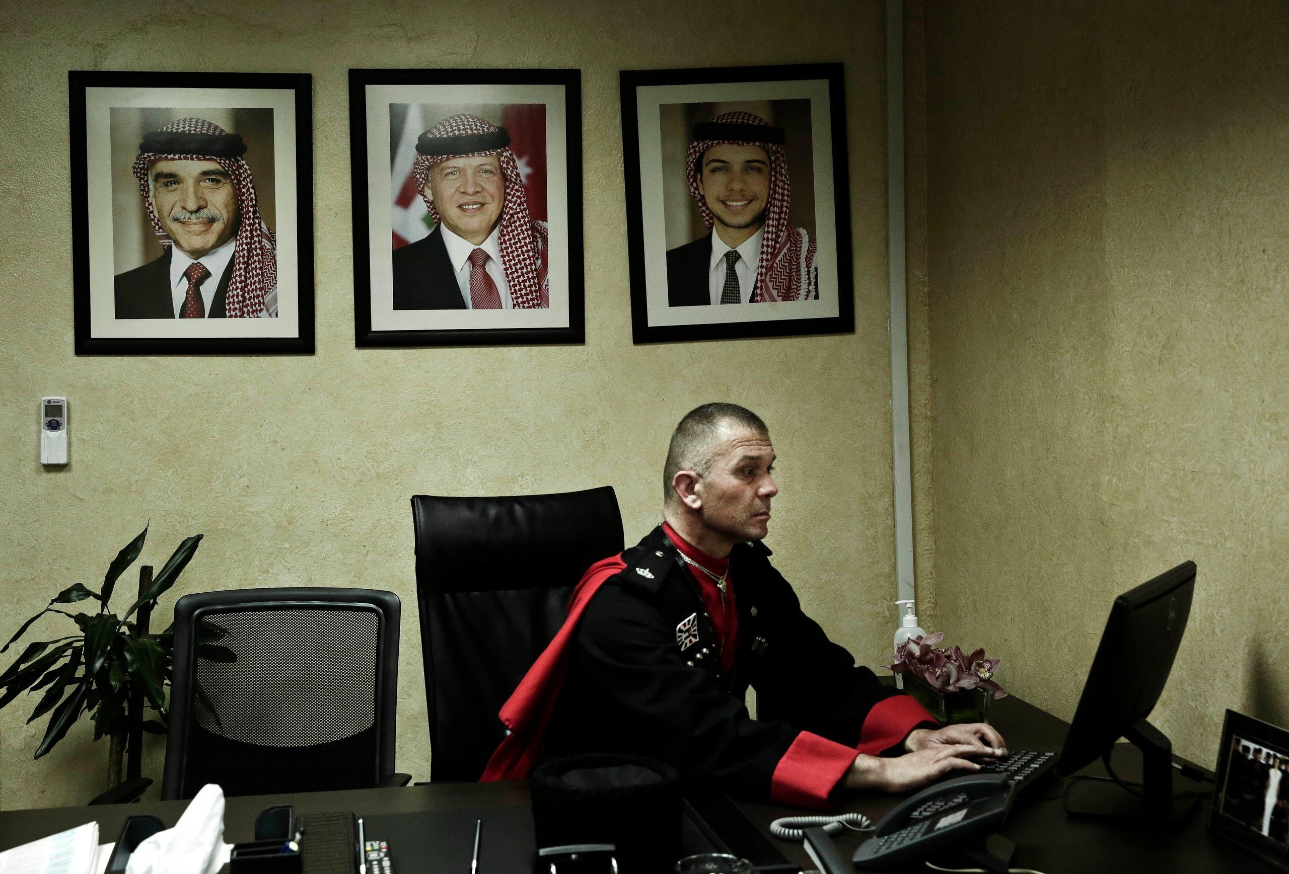 In this Monday, Jan. 11, 2016 photo, 45 year-old Circassian guard leader Major Ayman Abzakh, works at the Circassian Headquarters in Basman Palace, in Amman, Jordan.