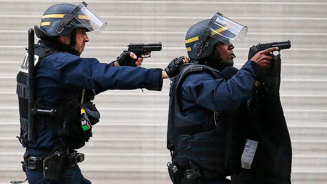 Police forces operate in Saint-Denis, a northern suburb of Paris, Wednesday, Nov. 18, 2015. Police say two suspects in last week's Paris attacks, a man and a woman, have been killed in a police operation north of the capital. Two police officers have been injured in the standoff. Police have said the operation is targeting the suspected mastermind of last week's attacks, believed to be holed up in an apartment in Saint-Denis with several other heavily armed suspects. (AP Photo/Francois Mori)