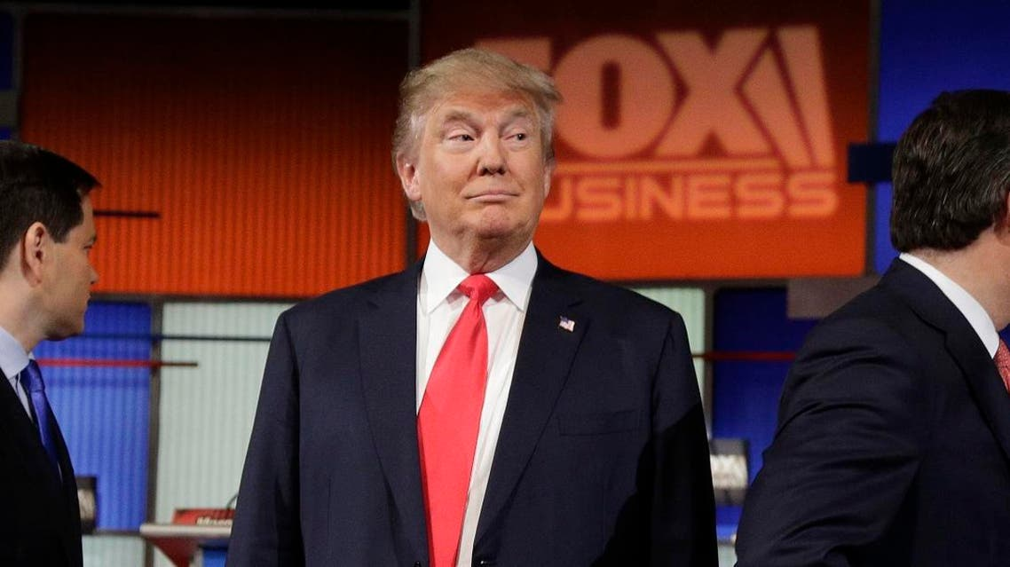 Republican presidential candidate, businessman Donald Trump stands on the stage before the Fox Business Network Republican presidential debate at the North Charleston Coliseum. (AP)