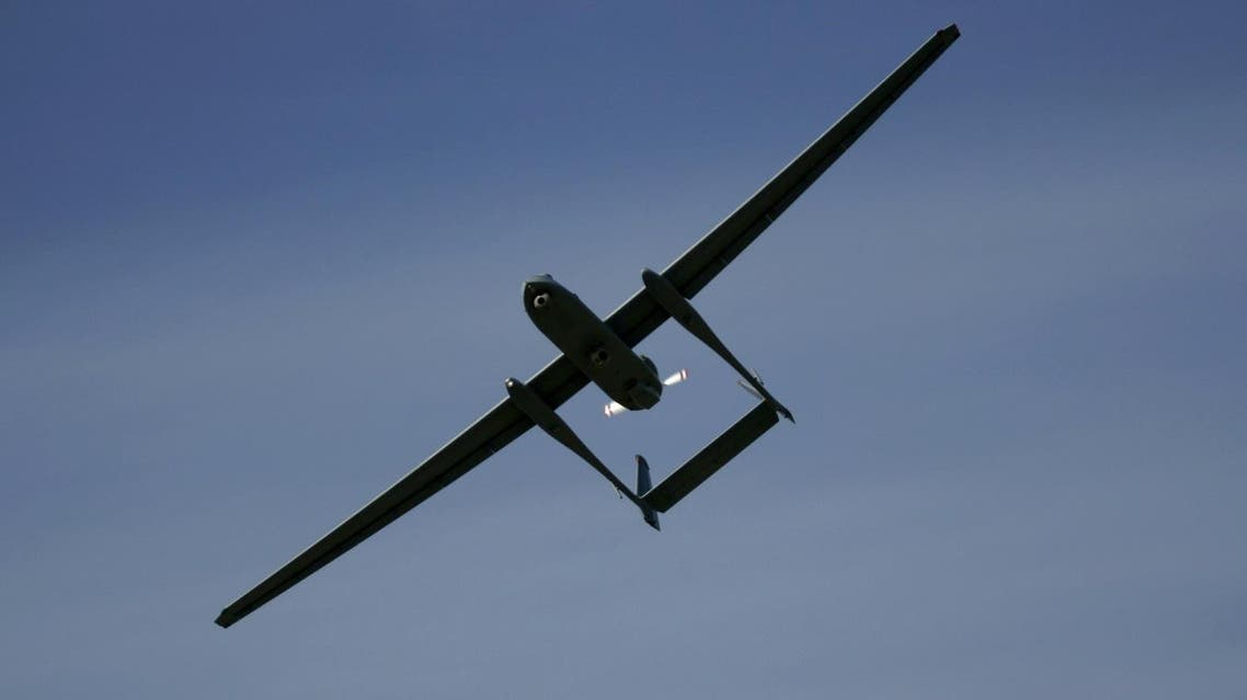 In this March 7, 2007 file photo The Israeli army's Heron unmanned drone aircraft for surveillance missions flies during a display at the Palmahim Air Force Base, Israel. AP