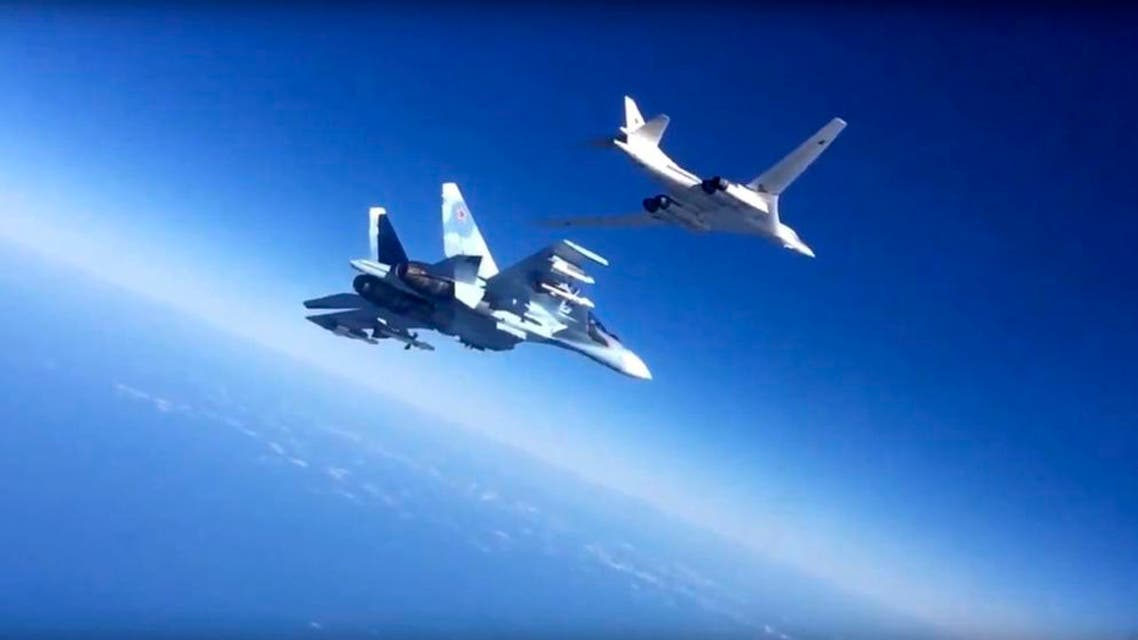 In this photo made from video released by Russian Defense Ministry official website on Friday, Nov. 20, 2015, a Russian air force Tu-160 bomber, right, is escorted by an Su-30SM on a combat mission against a target in Syria, according to information provided by Russian Defense Ministry. Russian long-range bombers and navy ships have launched 101 cruise missiles in four days, including 18 fired by Russian navy ships from the Caspian Sea on Friday, according to information released by Russian Defense Ministry.(AP Photo/ Russian Defense Ministry Press Service)