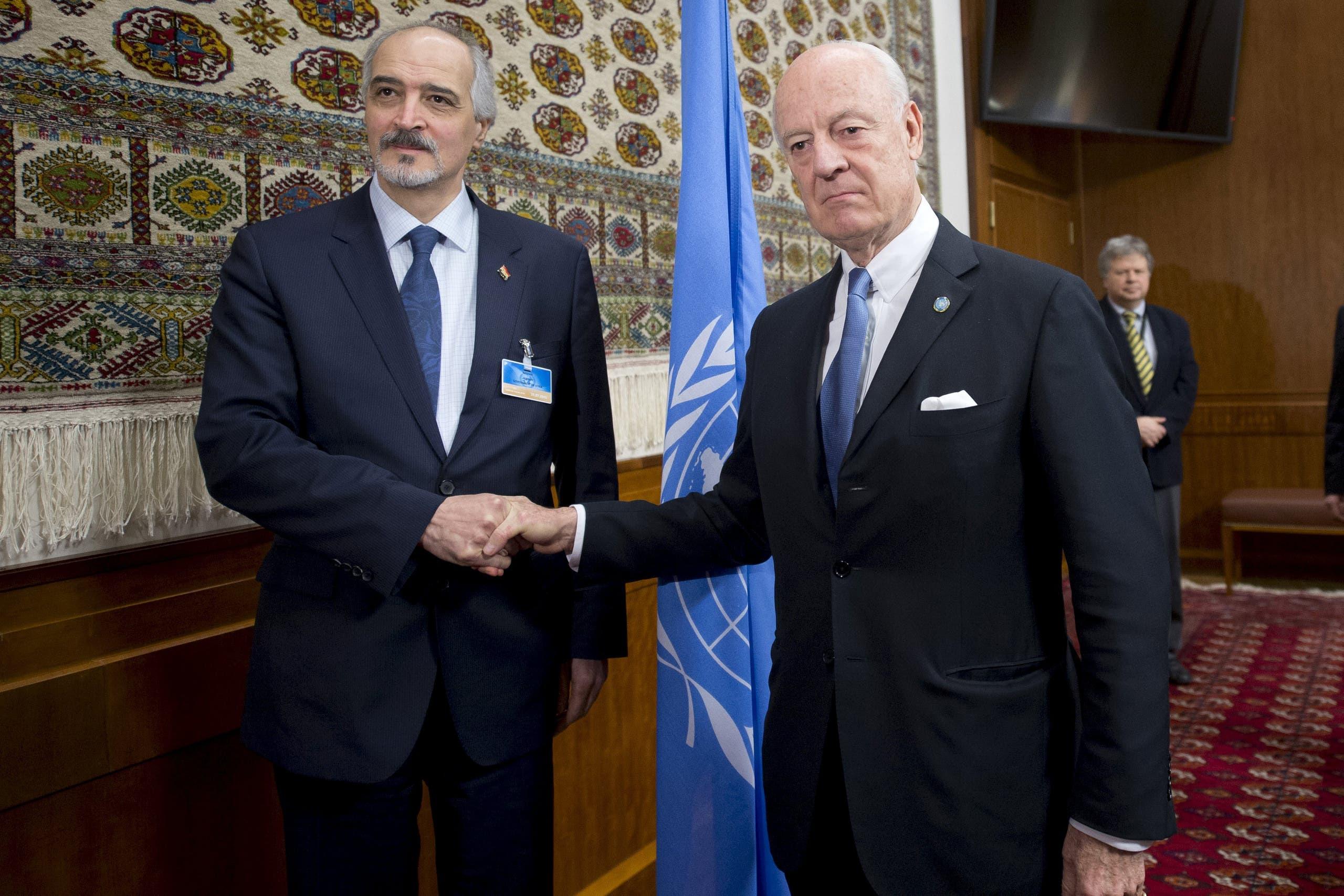 U.N. envoy Staffan de Mistura shakes hands with Syria's Ambassador to the United Nations Bashar al Jaafari (L) during the Syria peace talks in Geneva, Switzerland, January 29, 2016. (Reuters)