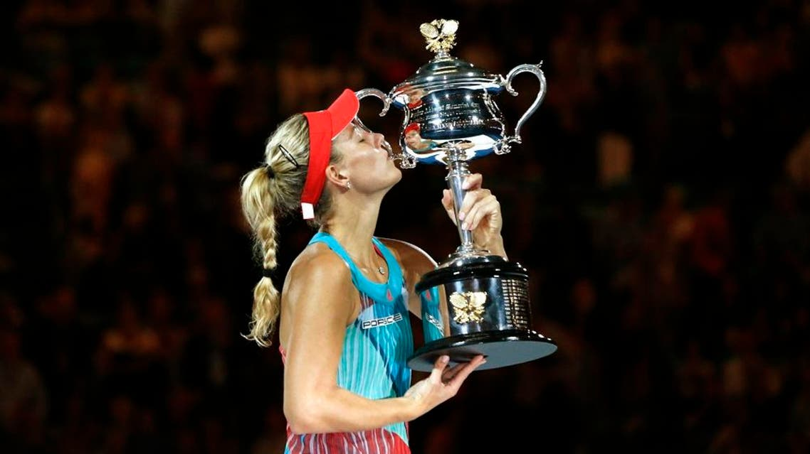 Germany's Angelique Kerber kisses the trophy after winning her final match against Serena Williams of the U.S. at the Australian Open tennis tournament at Melbourne Park, Australia, January 30, 2016 (Reuters)