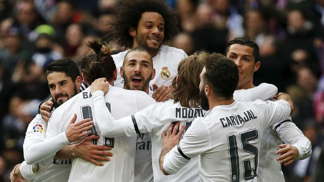 Real Madrid's Karim Benzema celebrates his first goal with teammates. REUTERS/Andrea Comas