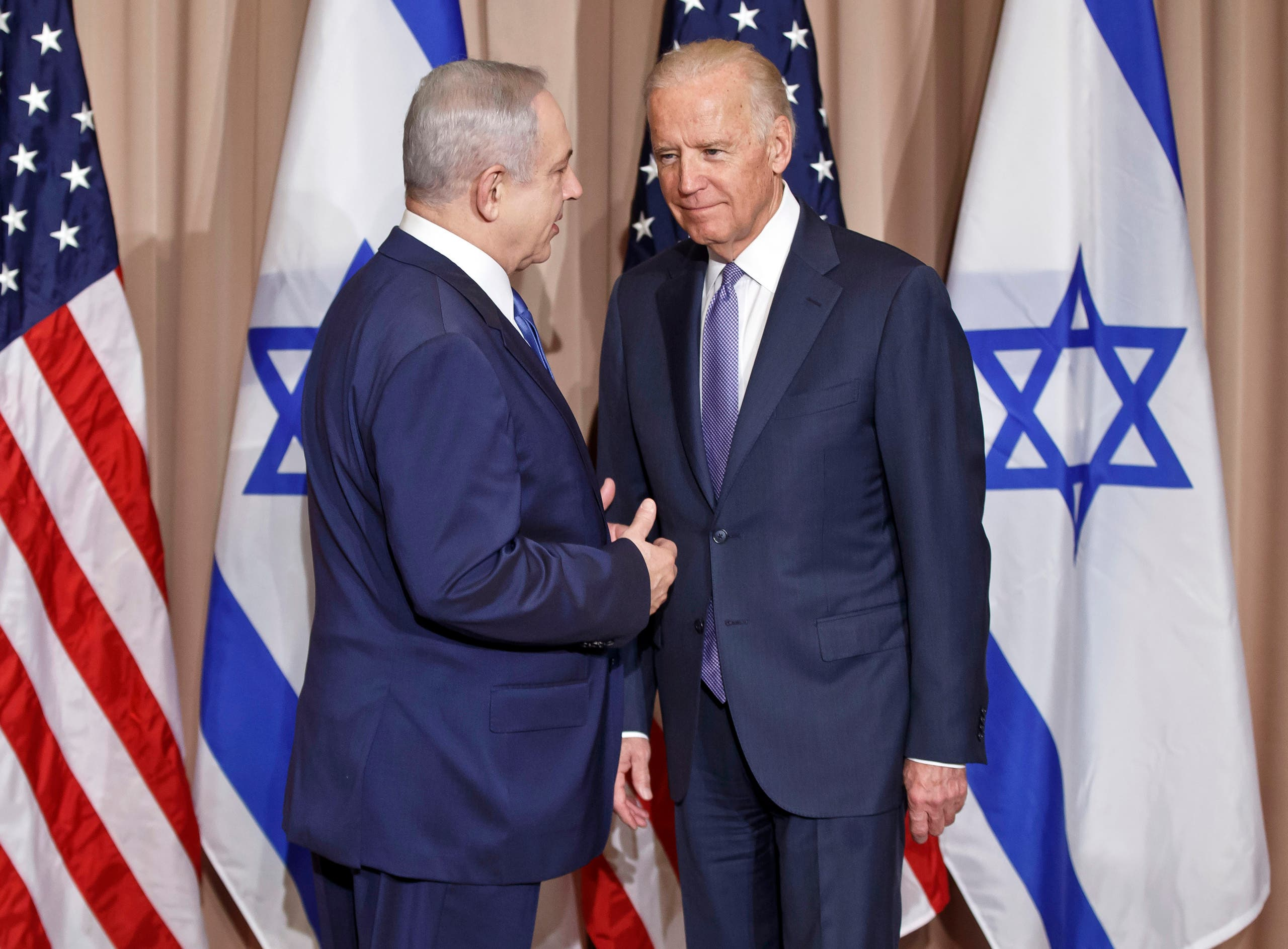 Israeli Prime Minister Benjamin Netanyahu, left, and US Vice-President Joe Biden pose for the media prior to a meeting on the sidelines of the World Economic Forum in Davos, Switzerland, Thursday, Jan. 21, 2016. (File photo: AP)