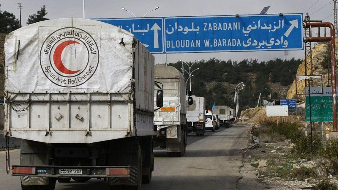 A convoy of aid from the Syrian Arab Red Crescent heads to the besieged rebel-held Syrian town of Madaya, on January 14, 2016 (AFP)