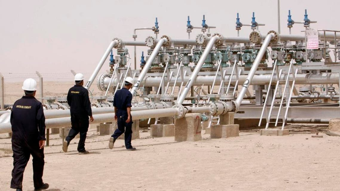 Oil industry workers are seen at a newly inaugurated gas processing facility at Tuba oil field in the southern oil-rich province of Basra, 550 kilometers (340 miles) southeast of Baghdad, Iraq, Saturday, June 4, 2011. Wasfi Tahir Bashit, who oversees production at the field, said the facility will process 20,000 barrels of crude oil a day. It will help capturing 30 million cubic feet of associated natural gas which was being wasted due to lack of infrastructure, Bashit said.(AP Photo/ Nabil al-Jurani)