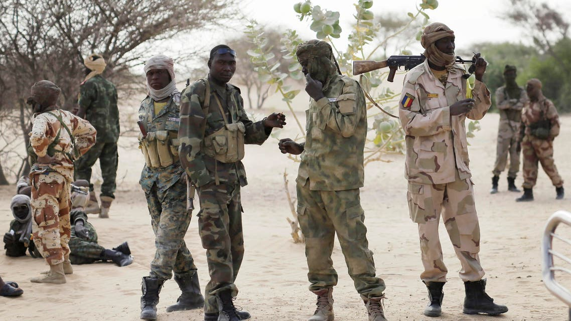 Chadian troops previously stationed by the Sudanese border make a stop on their way to lake Chad near Baga Sola Friday March 6, 2015. Large contingents of Chadian troops were seen heading to the region bordering Nigeria, where residents and an intelligence officer said Boko Haram fighters are massing at their headquarters in the northeast Nigerian town of Gwoza in preparation for a showdown with multinational forces. (AP Photo / Jerome Delay)